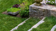 Stone steps and stone wall in landscaping