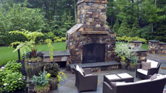 Patio and outdoor fireplace with garden furniture