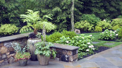 Container garden and patio with stone walls