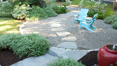 Pebble patio with stepping stones and outdoor seating
