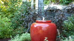 Garden pot sculpture and water feature with plantings